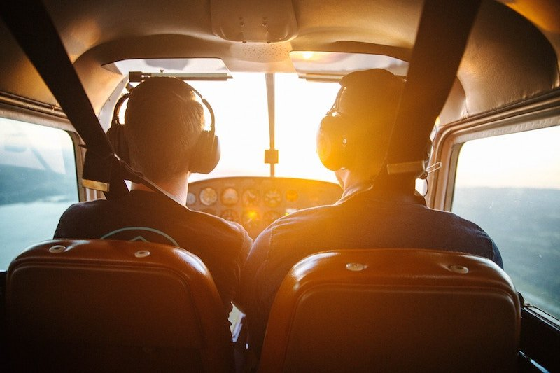 Instructor and student pilot in plane