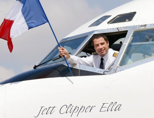 John Travolta waving to the crowd out of his Boeing 707 Jett Clipper Ella.