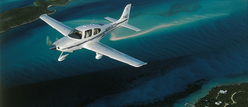 Cirrus SR22 flying over water